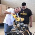 Jim Luckow using table saw with student
